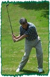 Down swing - unwind and release the golf club.